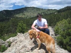 Posing on a rock in the off leash area with our wonderful Golden Retriever